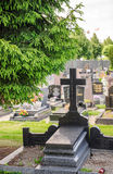 Cross on a grave in the cimitery Royalty Free Stock Image