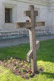 Cross on grave in monastery Stock Images