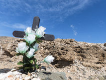 Cross on grave at seaside. Royalty Free Stock Photo