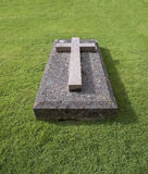 Cross on Grave Stone Stock Images