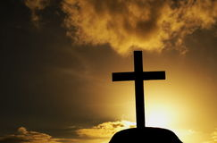 Cross at grave when sunset Stock Photos