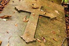 Cross on grave Stock Photo