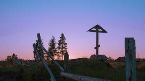 Cross on grave. White night in Karelia, Russia Royalty Free Stock Photography