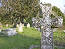 Cross in graveyard Stock Photography