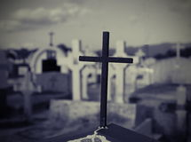 Cross in graveyard Stock Images