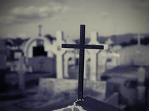 Cross in graveyard Stock Images