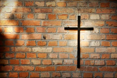 Cross and grunge wall on cemetery Royalty Free Stock Photo