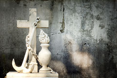 Cross and grunge wall on cemetery Royalty Free Stock Photography