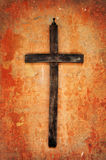 Cross on a grunge wall Stock Images
