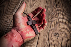 Cross in hand Royalty Free Stock Image