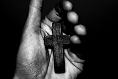 Cross hands. Christian symbol of the cross into the hands of men Stock Photos