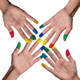 Cross with hands and painted finger tips Royalty Free Stock Photo