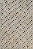 Cross-hatched metal plate. Cross-hatched metal anti-skid surface background pattern Royalty Free Stock Photo