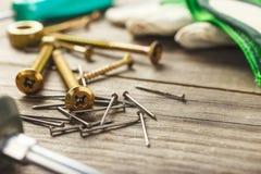 Cross head bolt screws thread with nails Royalty Free Stock Photos