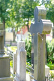 Cross headstone on grave Royalty Free Stock Photos