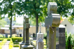 Cross headstone on grave Royalty Free Stock Images