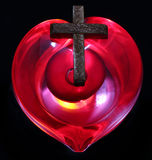 Cross Heart. Beautiful Glass heart with a wooden cross on it Royalty Free Stock Images