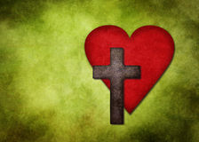 Cross With Heart On Green Background Royalty Free Stock