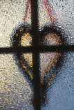 Cross and heart silhouette. Royalty Free Stock Image