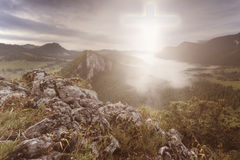Cross in the Heaven seen fromt he top of the mountain Royalty Free Stock Images