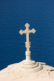 Cross high up over the sea Stock Photos