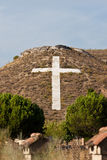 Cross on hill. A huge stone cross, embedded in a hill just outside of Madrid, Spain Stock Photos