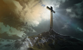 Cross on the hill. A wooden cross on a hill at sunset Royalty Free Stock Image