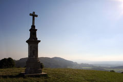 Cross on a hill. With blue sky Royalty Free Stock Photo