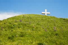 Cross on the hill. Christian cross on the top of green hill Stock Photos