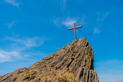 Cross on a hill Stock Images