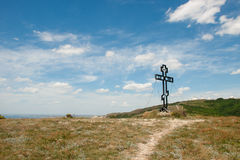 Cross of on the hill. View of the cross of on the hill and sky with clouds summer day Stock Photo
