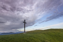 Cross on the hill. Wooden cross on the hill  in the early morning Royalty Free Stock Photo