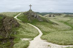 Cross on hilltop. A cross on the hilltop by a pathway in Wales, UK stock photo