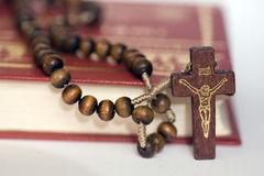 Cross and Holly Bible. Just a rosary on Holly Bible Royalty Free Stock Photography