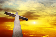 Cross. Holy cross with background of Sunset Stock Photo