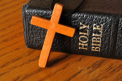 Cross and Holy Bible. Wooden cross laying on top of the Holy Bible Stock Photography