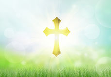 Cross. Holy Golden Cross and light on a bokeh background royalty free stock image
