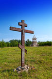 Cross in honor of the basis of church and under construction orthodox church on a hill Royalty Free Stock Photos