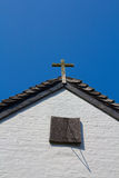 Cross on a house gable Stock Images