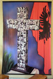 Cross with images murdered priests during the communist regime in Albania. St Paul`s Cathedral in Tirana, Albania Stock Image