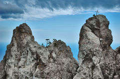 Cross in inaccessible mountain Stock Photo