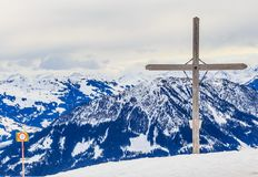 Cross and information pointer on top of the mountain Zinsberg Royalty Free Stock Images
