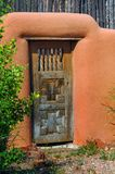 Cross Inlaid Door in Adobe Wall Royalty Free Stock Photography