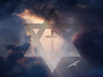 Cross inside Star of David. In Sky Royalty Free Stock Photography