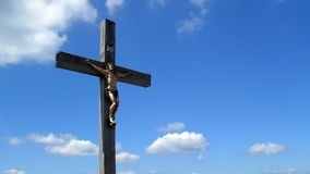 Cross with Jesus Christ on Lusen hill summit in Bayerischer Wald Stock Images