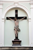 Cross of Jesus Christ on the wall. Cross Jesus Christ on a white wall Stock Images