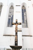 Cross with Jesus by Church of St. John the Baptist Royalty Free Stock Image