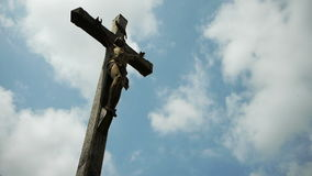 Cross with Jesus. A devotion cross with christ along the way in a little village at the countryside in Normandy, France. A low shot. The wooden old cross, a stock video