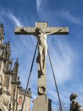 Cross with Jesus statue royalty free stock photography