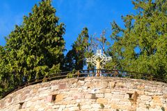 Cross with Jesus in village Turenne in French Correze royalty free stock image